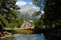 The Cascades Of Time Gardens Look Down On Bow River Bridge and Banff Avenue With Cascade Mountain In Summer